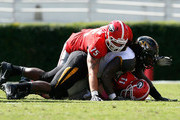 Aaron Murray and Markus Golden Photos Photo