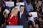 Republican presidential candidate and former Massachussetts Gov. Mitt Romney (R) and his wife Ann wave to supporters at a primary night gathering at the Suburban Collections Showplace on February 28, 2012 in Novi, Michigan. Romney celebrated primary victories in Arizona and Michigan.