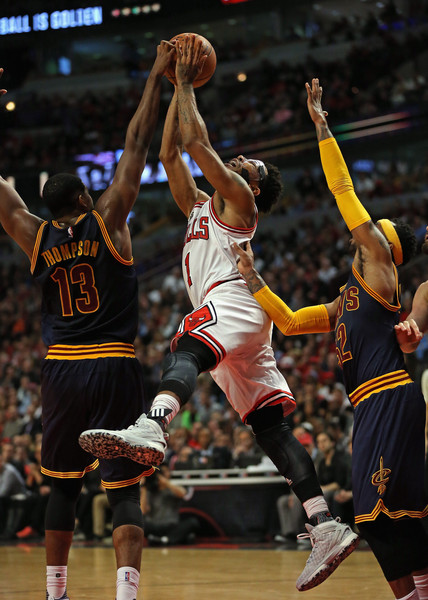 Cleveland Cavaliers v Chicago Bulls [photograph,basketball,player,sports,basketball moves,tournament,team sport,ball game,basketball player,basketball court,derrick rose,user,tristan thompson,mo williams,chicago,united center,cleveland cavaliers,chicago bulls,game]