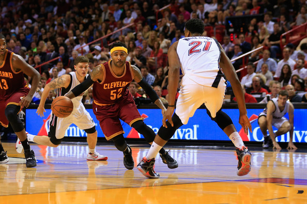 Cleveland Cavaliers v Miami Heat [photograph,player,basketball moves,sports,basketball court,basketball player,sport venue,tournament,team sport,ball game,fan,mo williams,user,user,user,note,miami,cleveland cavaliers,miami heat,game]