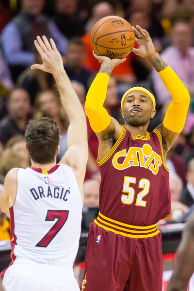 Miami Heat v Cleveland Cavaliers [photograph,player,sports,basketball player,basketball moves,team sport,ball game,fan,basketball,product,tournament,mo williams,user,user,goran dragic 7,note,cleveland,cleveland cavaliers,miami heat,half]