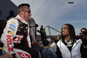 Austin Dillon, driver of the #3 Dow Coating Chevrolet, meets Migos prior to the Monster Energy NASCAR Cup Series Auto Club 400 at Auto Club Speedway on March 18, 2018 in Fontana, California.