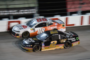 Brad Keselowski, driver of the #2 Miller Genuine Draft Ford, races Alex Bowman, driver of the #88 LLumar Chevrolet, during the Monster Energy NASCAR Cup Series Bojangles' Southern 500 at Darlington Raceway on September 2, 2018 in Darlington, South Carolina.