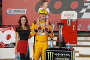 Kyle Busch, driver of the #18 M&M's Red White & Blue Toyota, poses with the trophy, his wife, Samantha, and son, Brexton, after winning the Monster Energy NASCAR Cup Series Coca-Cola 600 at Charlotte Motor Speedway on May 27, 2018 in Charlotte, North Carolina.
