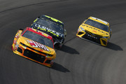 Chris Buescher, driver of the #37 Slim Jim Chevrolet, leads Jimmie Johnson, driver of the #48 Lowe's for Pros aChevrolet, nd Daniel Suarez, driver of the #19 Stanley Toyota, during the Monster Energy NASCAR Cup Series Consmers Energy 400 at Michigan International Speedway on August 12, 2018 in Brooklyn, Michigan.