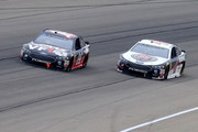 Clint Bowyer, driver of the #14 Haas 30 Years of the VF1 Ford, races Kevin Harvick, driver of the #4 Jimmy John's Ford, for the lead during the Monster Energy NASCAR Cup Series FireKeepers Casino 400 at Michigan International Speedway on June 10, 2018 in Brooklyn, Michigan.