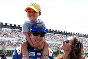 Kyle Busch, driver of the #18 M&M's Caramel Toyota, is joined by his wife Samantha and son Brexton during the Monster Energy NASCAR Cup Series Gander Outdoors 400 at Pocono Raceway on July 29, 2018 in Long Pond, Pennsylvania.