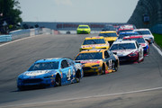 Kevin Harvick, driver of the #4 Busch Beer Ford, and Clint Bowyer, driver of the #14 Rush Truck Centers Ford, lead a pack of cars during the Monster Energy NASCAR Cup Series GoBowling at The Glen at Watkins Glen International on August 5, 2018 in Watkins Glen, New York.