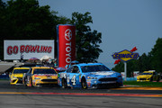 Kevin Harvick, driver of the #4 Busch Beer Ford, leads Clint Bowyer, driver of the #14 Rush Truck Centers Ford, during the Monster Energy NASCAR Cup Series GoBowling at The Glen at Watkins Glen International on August 5, 2018 in Watkins Glen, New York.