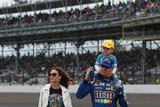 Kyle Busch, driver of the #18 M&M's Caramel Toyota, walks with his son, Brexton, and wife, Samantha, prior to the start of the Monster Energy NASCAR Cup Series Big Machine Vodka 400 at the Brickyard at Indianapolis Motor Speedway on September 10, 2018 in Indianapolis, Indiana.