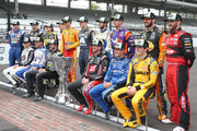 Kyle Busch, driver of the #18 M&M's Caramel Toyota, Aric Almirola, driver of the #10 Smithfield Ford, Ryan Blaney, driver of the #12 BODYARMOR Ford, Brad Keselowski, driver of the #2 Discount Tire Ford, Joey Logano, driver of the #22 Shell Pennzoil Ford, Alex Bowman, driver of the #88 Axalta Chevrolet, Chase Elliott, driver of the #9 NAPA Auto Parts Chevrolet, Denny Hamlin, driver of the #11 FedEx Possibilities Toyota, Martin Truex Jr., driver of the #78 Auto-Owners Insurance Toyota, Austin Dillon, driver of the #3 Dow MOLYKOTE Chevrolet, Kevin Harvick, driver of the #4 Jimmy John's New 9-Grain Wheat Sub Ford, Clint Bowyer, driver of the #14 Mobil 1/Rush Truck Centers Ford, Jimmie Johnson, driver of the #48 Lowe's for Pros Chevrolet, Kurt Busch, driver of the #41 Haas Automation/Monster Energy Ford, Kyle Larson, driver of the #42 Credit One Bank Chevrolet, Erik Jones, driver of the #20 buyatoyota.com Toyota, pose for a photo after making the NASCAR Playoffs following the Monster Energy NASCAR Cup Series Big Machine Vodka 400 at the Brickyard at Indianapolis Motor Speedway on September 10, 2018 in Indianapolis, Indiana.