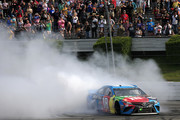Kyle Busch, driver of the #18 M&M's Hazelnut Toyota, celebrates with a burnout after winning the Monster Energy NASCAR Cup Series Pocono 400 at Pocono Raceway on June 02, 2019 in Long Pond, Pennsylvania.