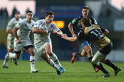 Ben Youngs (L) of Leicester Tigers runs at Yohann Artru (R) of Montpellier during the Heineken Cup Pool 5 match between Montpellier and Leicester Tigers at Stade Yves Du Manoir on December 15, 2013 in Paris, France.