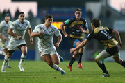 Ben Youngs (C) of Leicester Tigers runs at Yohann Artru (R) of Montpellier during the Heineken Cup Pool 5 match between Montpellier and Leicester Tigers at Stade Yves Du Manoir on December 15, 2013 in Paris, France.