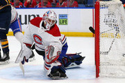 Antti Niemi #37 of the Montreal Canadiens makes a glove save against the Buffalo Sabres during the second period at KeyBank Center on March 23, 2018 in Buffalo, New York.
