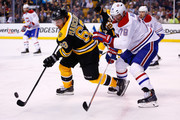 Brad Marchand #63 of the Boston Bruins skates with the puck as Andrei Markov #79 of the Montreal Canadiens defends during Game Seven of the Second Round of the 2014 NHL Stanley Cup Playoffs at the TD Garden on May 14, 2014 in Boston, Massachusetts.