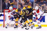 Milan Lucic #17 of the Boston Bruins attempts to posess the puck in front of Andrei Markov #79 of the Montreal Canadiens in the second period in Game One of the Second Round of the 2014 NHL Stanley Cup Playoffs on May 1, 2014 in Boston, Massachusetts.