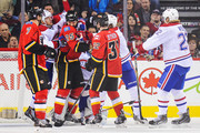 Andrei Markov #79 of the Montreal Canadiens mixes it up with Brandon Bollig #25 of the Calgary Flames after the whistle during an NHL game at Scotiabank Saddledome on October 28, 2014 in Calgary, Alberta, Canada.