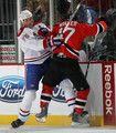 Hal Gill #75 of the Montreal Canadiens hits Ben Walter #17 of the New Jersey Devils at the Prudential Center on January 22, 2010 in Newark, New Jersey.
