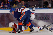 Andrei Markov #79 of the Montreal Canadiens is tripped up by Casey Cizikas #53 of the New York Islanders at the Nassau Veterans Memorial Coliseum on March 21, 2013 in Uniondale, New York.