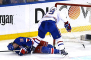 J.T. Miller #10 of the New York Rangers gets checked into the goal post by Andrei Markov #79 of the Montreal Canadiens in the second period during Game Four of the Eastern Conference Final in the 2014 NHL Stanley Cup Playoffs at Madison Square Garden on May 25, 2014 in New York City.