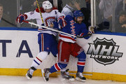 Martin St. Louis #26 of the New York Rangers and Andrei Markov #79 of the Montreal Canadiens crash into the baords in Game Three of the Eastern Conference Final during the 2014 NHL Stanley Cup Playoffs at Madison Square Garden on May 22, 2014 in New York City.