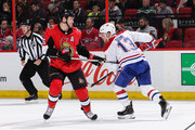 Zack Smith #15 of the Ottawa Senators tries to get his stick free from Max Domi #13 of the Montreal Canadiens at Canadian Tire Centre on October 20, 2018 in Ottawa, Ontario, Canada.