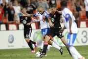 Marco Di Vaio #9 of the Montreal Impact controls the ball against Perry Kitchen #23 of D.C. United at RFK Stadium on June 30, 2012 in Washington, DC.