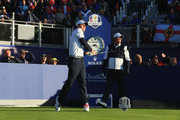 Keegan Bradley of the United States hits his opening tee shot on the 1st hole as Phil Mickelson of the United States looks on during the Morning Fourballs of the 2014 Ryder Cup on the PGA Centenary course at the Gleneagles Hotel on September 26, 2014 in Auchterarder, Scotland.