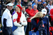 Bubba Watson of the United States and wife Angie Watson look on with Webb Simpson of the United States and his wife Dowd Simpson on the 14th hole during the Morning Fourballs of the 2014 Ryder Cup on the PGA Centenary course at the Gleneagles Hotel on September 26, 2014 in Auchterarder, Scotland.