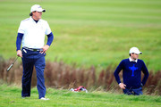 Phil Mickelson (L) and Keegan Bradley of the United States walk down the 15th hole during the Morning Fourballs of the 2014 Ryder Cup on the PGA Centenary course at the Gleneagles Hotel on September 26, 2014 in Auchterarder, Scotland.