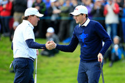 Phil Mickelson (L) of the United States shakes hands with Keegan Bradley on the 14th green during the Morning Fourballs of the 2014 Ryder Cup on the PGA Centenary course at the Gleneagles Hotel on September 26, 2014 in Auchterarder, Scotland.