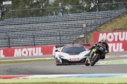 "Johann Zarco of France and Monster Yamaha Tech 3 (R) rides the bike and leads Bruno Senna of Brazil drives the car during the pre-event ""A race between a Yamaha M1 and a McLaren GT3"" during the MotoGP Netherlands - Preview on June 22, 2017 in Assen, Netherlands."