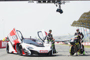 """Johann Zarco of France and Monster Yamaha Tech 3 and Bruno Senna . of Brasile (R) pose with the bike and the car during the pre-event """"A race between a Yamaha M1 and a McLaren GT3"""" during the MotoGP Netherlands - Preview on June 22, 2017 in Assen, Netherlands."""