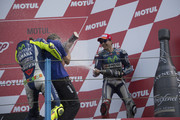 Valentino Rossi of Italy and Movistar Yamaha MotoGP and Jorge Lorenzo of Spain and Movistar Yamaha MotoGP (R) celebrate with champagne on the podium at the end of the MotoGP race during the MotoGP Netherlands - Race at  on June 27, 2015 in Assen, Netherlands.