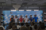 (L-R)  Pol Espargaro of Spain and Red Bull KTM Factory Racing,  Cal Crutchlow of Great Britain and LCR Honda, Andrea Dovizioso of Italy and Ducati Team, Marc Marquez of Spain and Repsol Honda Team, Maverick Vinales of Spain and  Movistar Yamaha MotoGP and  Alex Rins of Spain and Team Suzuki ECSTAR pose during the press conference pre-event during the MotoGP of Aragon - Previews  at Motorland Aragon Circuit on September 20, 2018 in Alcaniz, Spain.