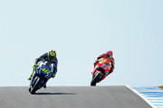 Valentino Rossi of Italy and Movistar Yamaha MotoGP and  Marc Marquez of Spain and the Repsol Honda team warm up ahead of the 2015 MotoGP of Australia at Phillip Island Grand Prix Circuit on October 18, 2015 in Phillip Island, Australia.