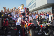 Marc Marquez of Spain and Repsol Honda Team celebrates the MotoGP victory and becoming the 2018 MotoGP champion at the end of the MotoGP race under the podium with team during the MotoGP of Japan - Race at Twin Ring Motegi on October 21, 2018 in Motegi, Japan.