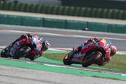 Marc Marquez of Spain and Repsol Honda Team leads Jorge Lorenzo of Spain and Ducati Team  during the MotoGP race during the MotoGP of San Marino - Race at Misano World Circuit on September 9, 2018 in Misano Adriatico, Italy.