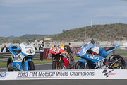 The bikes of Pol Espargaro  of Spain and Pons 40 HP Tuenti,  Marc Marquez of Spain and Repsol Honda Team and Maverick Vinales of Spain and Team Calvo (World Champions) pose on track during the MotoGP of Valencia - Race at Ricardo Tormo Circuit on November 10, 2013 in Valencia, Spain.