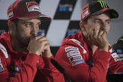 Andrea Dovizioso of Italy and Ducati Team and  Jorge Lorenzo of Spain and Ducati Team (R) look on during the press conference at the end of the qualfying practice during the MotoGp Of Great Britain - Qualifying at Silverstone Circuit on August 25, 2018 in Northampton, England.