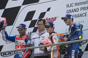 (L-R) Danilo Petrucci of Italy and  Pramac Racing,   Marc Marquez of Spain and Repsol Honda Team and Valentino Rossi of Italy and Movistar Yamaha MotoGP celebrate on the podium at the end of the MotoGP race during the  MotoGp of France - Race on May 20, 2018 in Le Mans, France.