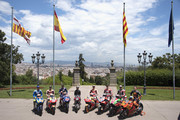 """(L-R) Alex Rins of Spain and Team Suzuki ECSTAR, Dani Pedrosa of Spain and Repsol Honda Team, Maverick Vinales of Spain and  Movistar Yamaha MotoGP,  Salvador Caellas of Spain (L) (the first ever win for Spain in the World Championship), Marc Marquez of Spain and Repsol Honda Team, Jorge Lorenzo of Spain and Ducati Team, Aleix Espargaro of Spain and Aprilia Racing Team Gresini and Pol Espargaro of Spain and Red Bull KTM Factory Racing pose with the bikes during the pre-event """"Past meets present: MotoGPª during the photo opportunity in the Jardines de Juan Maragall in Barcelona at Circuit de Catalunya on June 13, 2018 in Montmelo, Spain."""