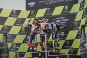 (L-R) Marc Marquez of Spain and Repsol Honda Team, Jorge Lorenzo of Spain and Ducati Team and Valentino Rossi of Italy and Movistar Yamaha MotoGP celebrate on the podium at the end of the MotoGP race during the  MotoGp of Catalunya - Race at Circuit de Catalunya on June 17, 2018 in Montmelo, Spain.