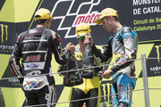(L-R) Johann Zarco of French and AJO Motorsport, Alex Rins of Spain and Pagina Amarillas HP40 and Esteve Rabat of Spain and Estrella Galicia 0,0 Marc VDS celebrate on the podium at the end of the Moto2 race during the MotoGp of Catalunya - Race at Circuit de Catalunya on June 14, 2015 in Montmelo, Spain.