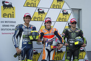 Valentino Rossi of Italy and Yamaha Factory Racing, Marc Marquez of Spain and Repsol Honda Team and Cal Crutchlow of Great Britain and Monster Yamaha Tech 3 pose at the end of the MotoGp of Germany - Qualifying at Sachsenring Circuit on July 13, 2013 in Hohenstein-Ernstthal, Germany.