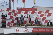 (L-R) Valentino Rossi of Italy and Movistar Yamaha MotoGP, Marc Marquez of Spain and Repsol Honda Team and Maverick Vinales of Spain and  Movistar Yamaha MotoGP celebrate on the podium at the end of the MotoGP race during the MotoGp of Germany - Race at Sachsenring Circuit on July 15, 2018 in Hohenstein-Ernstthal, Germany.