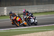 Marc Marquez of Spain and Team Catalunya Caixa Repsol  leads Pol Espargaro of Spain and Pons 40 HP Tuenti during the Moto2 race of MotoGP of Qatar at Losail Circuit on April 8, 2012 in Doha, Qatar.