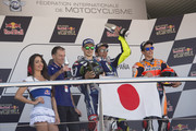 (L-R) Jorge Lorenzo of Spain and Movistar Yamaha MotoGP, Valentino Rossi of Italy and Movistar Yamaha MotoGP and Marc Marquez of Spain and Repsol Honda Team celebrate with the Japan Flag on the podium at the end of the MotoGP race during the MotoGp of Spain - Race at Circuito de Jerez on April 24, 2016 in Jerez de la Frontera, Spain.