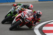 Lorenzo Savadori of Italy and Tom Sykes of Great Britain in action during race two of Motul FIM Superbike World Championship at Donington Park on May 27, 2018 in Castle Donington, England.